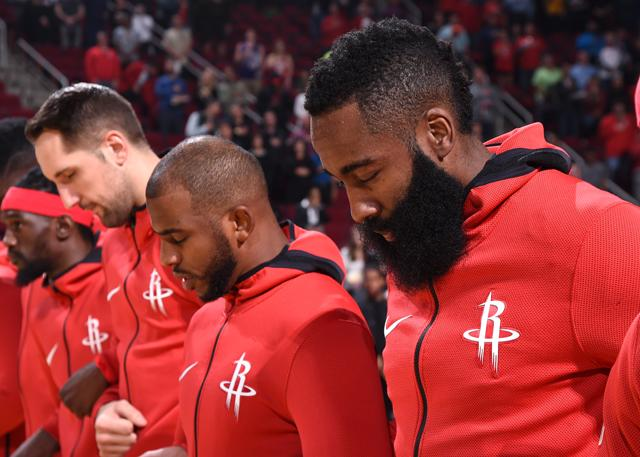 HOUSTON, TX - DECEMBER 18:  James Harden #13 and Chris Paul #3 of the Houston Rockets with their teammates stand for the National Anthem against the Utah Jazz on December 18, 2017 at the Toyota Center in Houston, Texas. NOTE TO USER: User expressly acknowledges and agrees that, by downloading and or using this photograph, User is consenting to the terms and conditions of the Getty Images License Agreement. Mandatory Copyright Notice: Copyright 2017 NBAE (Photo by Bill Baptist/NBAE via Getty Images)